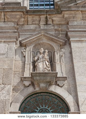 PORTO PORTUGAL - MAY 26 2016: Statue of Saint Joseph on facade of Carmelitas Church (17th c.) in the historical center of Porto Portugal. World Heritage Site of UNESCO
