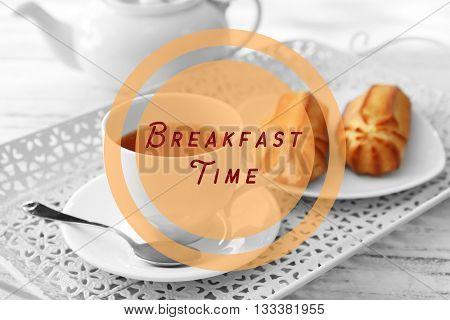 Text Breakfast Time and tea with pastries filled with custard on the tray