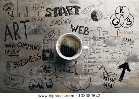 Cup of coffee on wooden table, top view. Start up concept