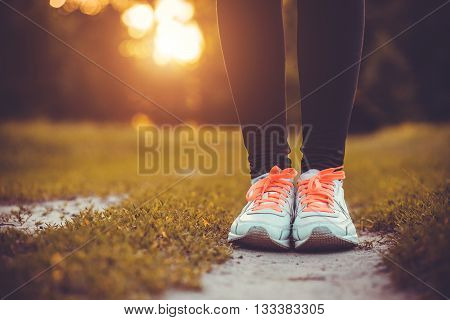Close up picture of white sole from running shoe in a park on a sunny day