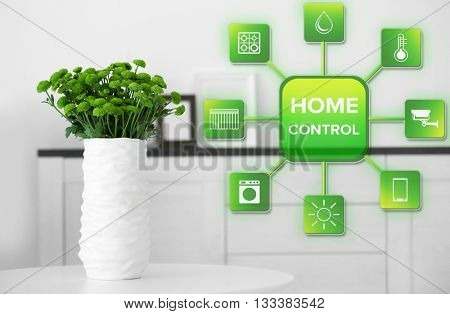 Smart home control concept. Room interior, vase with flowers on table