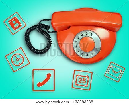 Retro phone with icons on blue background