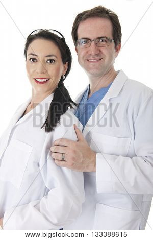 Portrait of a male and female doctor in scrubs and lab coat happily posing together.  On a white background.