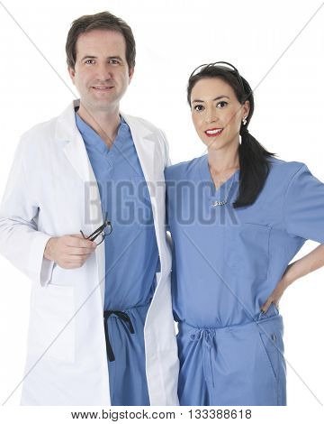 A male doctor and female doctor (or nurse/s) with their arms around each other, happily looking at the viewer.  Both are wearing blue scrubs, the man also wears a lab coat.  On a white background.