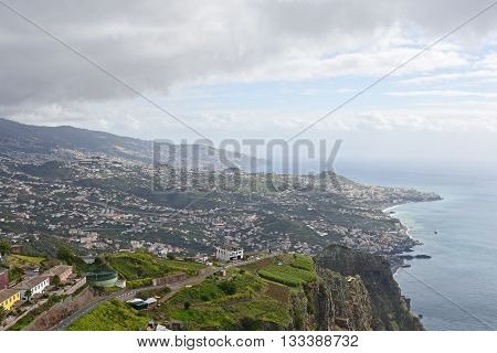 View towards Camara de Lobos and Funchal from Cabo Girao in Madeira Portugal. (one of the highest cliffs in the world 590 metres)