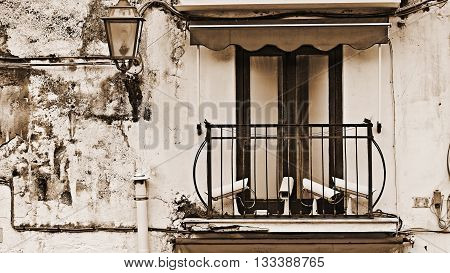 Balcony of the Old Italian House with CCTV Vintage Style Sepia
