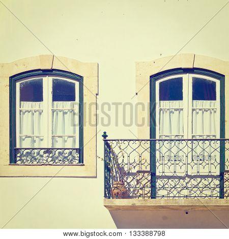 Portuguese Windows with a Balcony Retro Effect