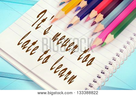 Text It's never too late to learn on notebook page