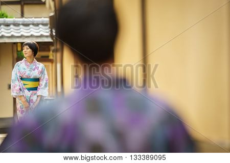 KYOTO, JAPAN - JUNE 10: Unidentified woman dress in traditional clothes, Japanese women usually dress in traditional clothes for a walk in Kyoto on June 10, 2015 in Japan