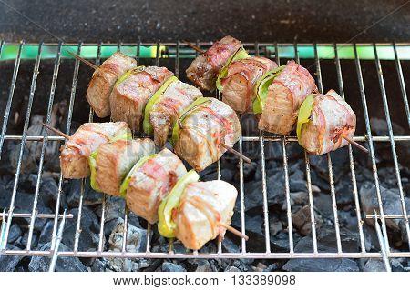 Beef shish kebab skewers on the grill closeup