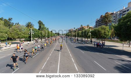 VALENCIA - MAY 15: unidentified group of runners lead the -Volta a Peu- in the first kilometer, Volta a peu is a popular race in Valencia on May 15, 2016 in Valencia, Spain