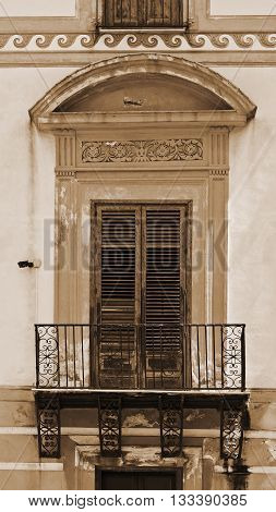 Italian Window in Palermo with Closed Wooden Shutters Vintage Style Sepia