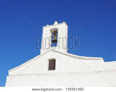 White church on Ibiza, Spain. Bell tower.