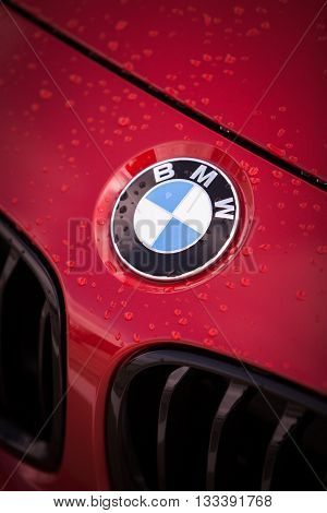 Bucharest Romania - May 22 2016: Detail of the vent of a BMW logo on a car on a rainy day. BMW is a vehicle motorcycle and engine manufacturing company from Munich Bavaria Germany