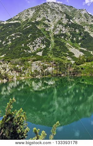 Landscape with Reflection of Hvoynati peak in Okoto lake, Pirin Mountain, Bulgaria