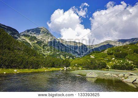 Amazing view of Muratov peak and mountain river in Pirin Mountain, Bulgaria