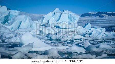 Beautiful view of icebergs in Jokulsarlon glacier lagoon Iceland selective focus global warming and climate change concept