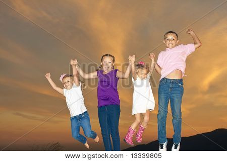 Happy Kids Jumping Together