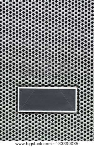 Metal Plate Label On Metal Steel Grid With Repetitive Rows Of Punched Circular Holes, Background And