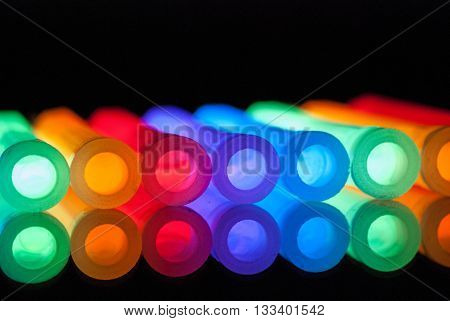 COLORFUL ILLUMINATED GLOW STICKS IN A ROW
