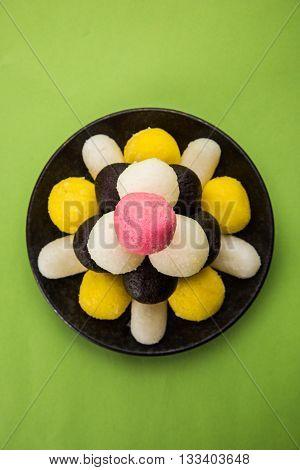 Gulab Jamun or kala jamun and Chum Chums or multicolour rassgulla or rasagulla, famous bengali sweets, selective focus