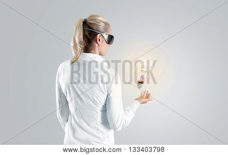 Woman in virtual reality glasses looking to the hologram, isolated. Shirt person stand back looking 3d cyber headset display. Wearable vr computer head set goggles watching. Man gaming glasses vision