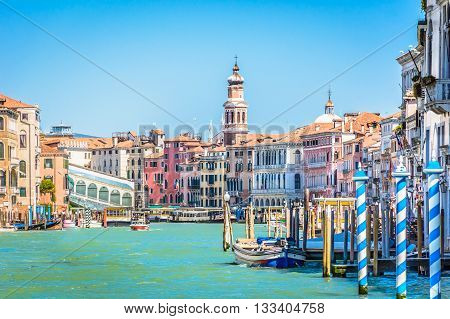 Idyllic waterfront view at marble Venice,famous touristic destination, during renovation of Rialto bridge.