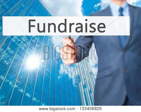 Fundraise - Businessman Hand Holding Sign