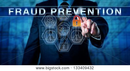 Male forensic expert is touching FRAUD PREVENTION on an interactive transparent control screen. Information technology concept for forensic or predictive analytics internet fraud and cyber crime.