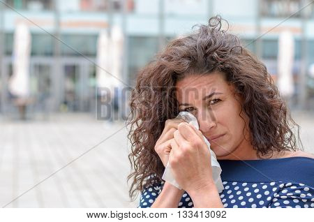 Tearful Young Woman Wiping Her Eyes