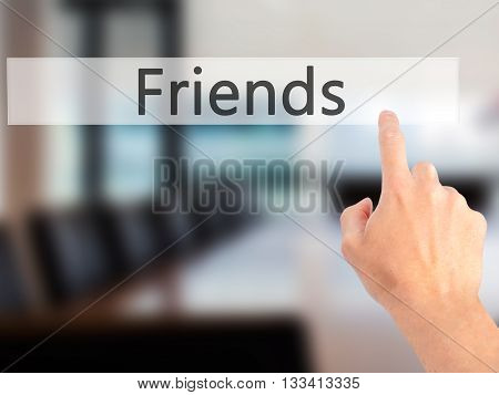 Friends - Hand Pressing A Button On Blurred Background Concept On Visual Screen.