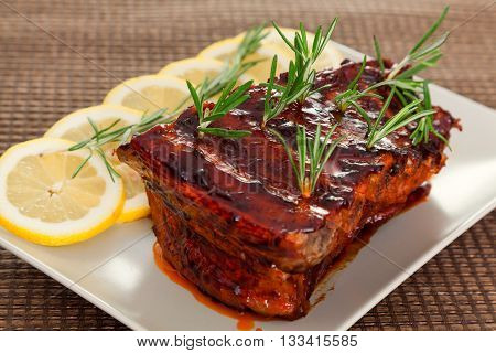 Slow cooked pork ribs with rosemary. Horizontal view.