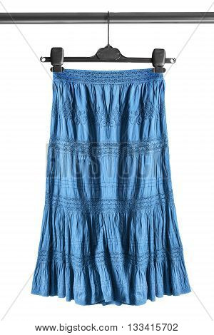 Blue ethnic skirt on clothes rack isolated over white