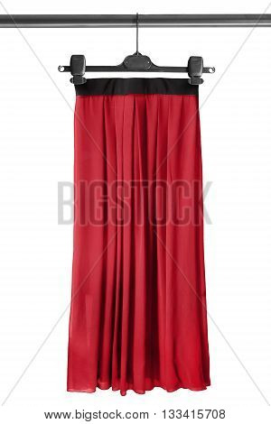 Red maxi skirt on clothes rack isolated over white
