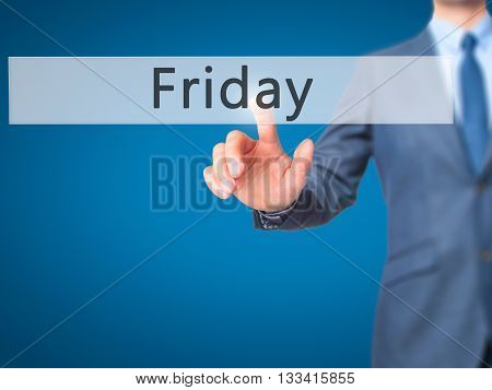Friday - Businessman Hand Pressing Button On Touch Screen Interface.