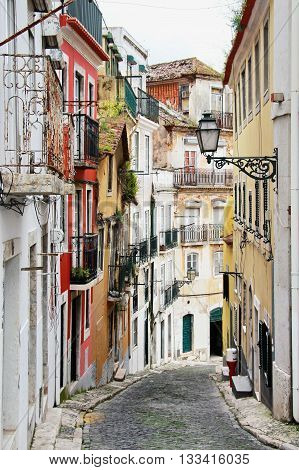 One of the oldest streets in Portugal. Colorful houses and cobblestone pavement of.