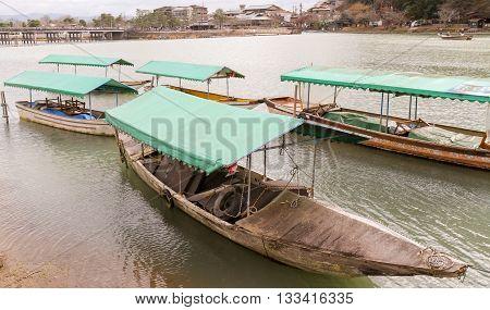 Pleasure boats on the Hozu-Gawa River, Arashiyama, Kyoto Japan
