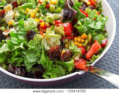 Green salad with tomatoes and peppers. Horizontal view shot from above