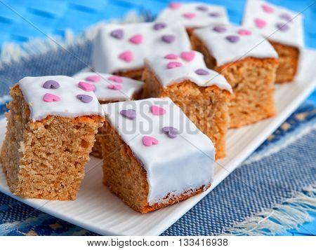 Homemade Caramel cake cut into squares shot from above. Horizontal close up shot