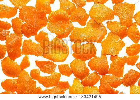 Tangerine pelts scattered on a white background