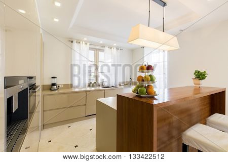 Spacious kitchen in modern style with decorative lighting
