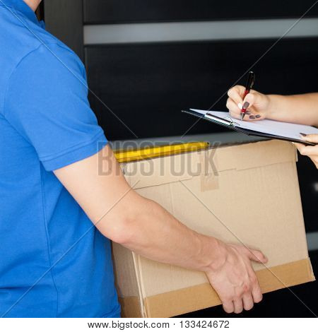 Courier Delivering A Parcel