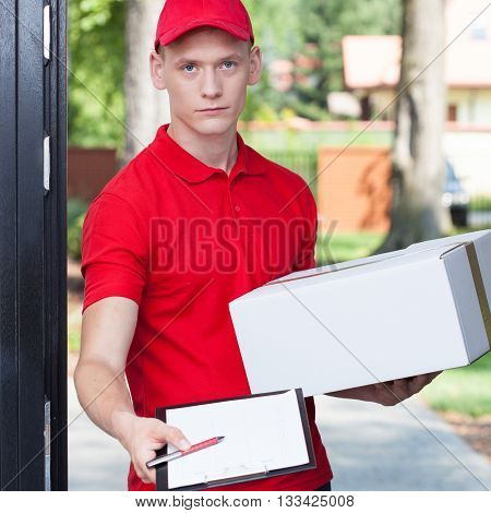 Delivery Man Requesting A Signature