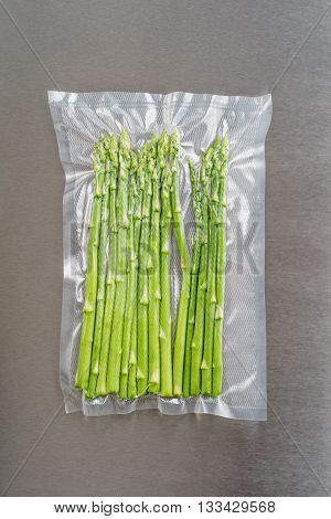 Green asparagus sealed in an airtight plastic bag ready for sous vide cooking