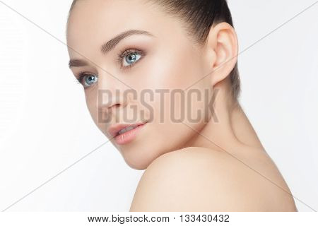 The beautiful female face. The perfect and clean skin of face on white