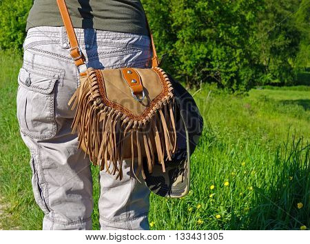 handbag with tassels draped over shoulder girls