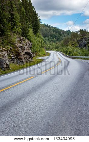 Empty flat mountain road in Norway with the left turn
