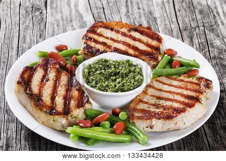 grilled pork chops on a white dish