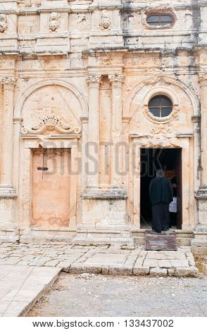Famous Greek monastery of Arkadi with an unrecognized monk walking in the church in Rethymno area Crete Island Greece