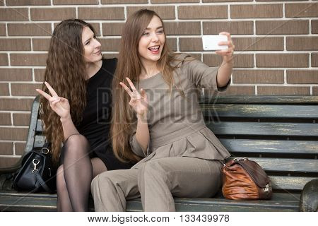 Two Young Beautiful Women Taking A Selfie On The Street